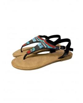 sandalias planas negras con tachuelas